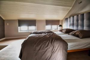 A bed or beds in a room at Bibi Tongeren