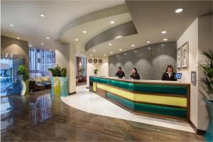 The lobby or reception area at Savoy Central Hotel Apartments