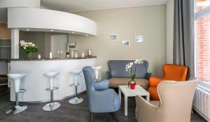 The lounge or bar area at Hôtel des Marais Salants