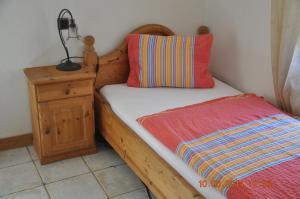Ein Bett oder Betten in einem Zimmer der Unterkunft Gasthof zur Post