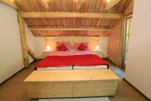 A bed or beds in a room at Chalet Zlatorog