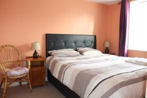 A bed or beds in a room at Serviced Apartments Wexford