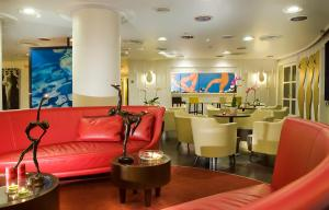 The lounge or bar area at Hotel Abitart