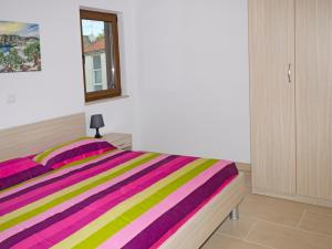 A bed or beds in a room at Sanja Apartments Rivarela