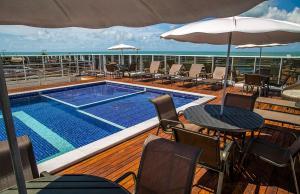 The swimming pool at or near Laguna Praia Hotel