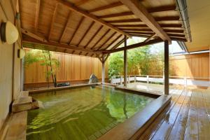 The swimming pool at or near Akita Onsen Plaza