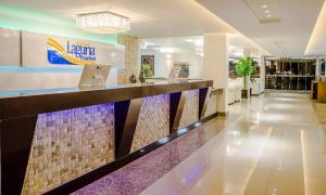 The lobby or reception area at Laguna Praia Hotel