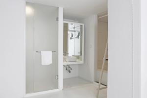A bathroom at Small House Big Door