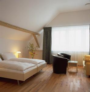 Ein Bett oder Betten in einem Zimmer der Unterkunft Landgasthof Leuen