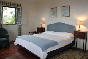 A bed or beds in a room at Quinta Sao Goncalo