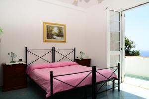 A bed or beds in a room at Hotel Villa Bernardina