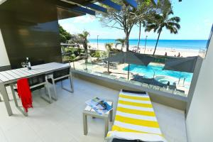 A view of the pool at Seahaven Noosa Beachfront Resort or nearby