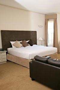 A bed or beds in a room at Beau Monde International
