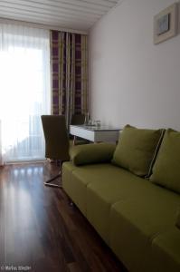 Ein Sitzbereich in der Unterkunft Gästehaus Ringbauer