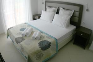 A bed or beds in a room at Mare D'Oro