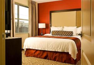 A bed or beds in a room at Residence Inn by Marriott Fairfax City