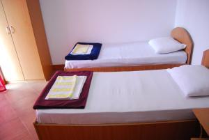 Un pat sau paturi într-o cameră la Vila Anda