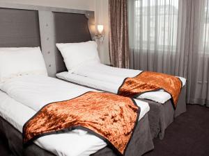 En eller flere senge i et værelse på Clarion Hotel Ernst
