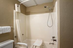 A bathroom at Super 8 by Wyndham Blackwell