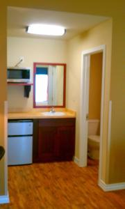 A kitchen or kitchenette at FieldHouse Inn & Conference Center