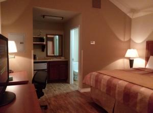 A bed or beds in a room at FieldHouse Inn & Conference Center