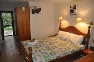 A bed or beds in a room at The Fig Tree B&B