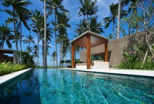 The swimming pool at or near Candi Beach Villas