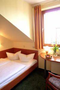 A bed or beds in a room at Landhotel Dresden