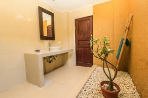 A bathroom at Radiant Jepun Villa