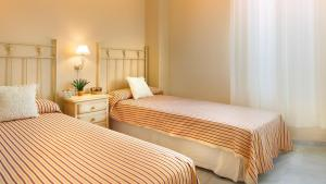 A bed or beds in a room at Life Apartments Costa Ballena