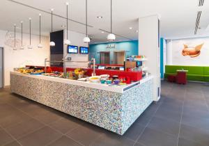 A restaurant or other place to eat at ibis Styles Hotel Berlin Mitte