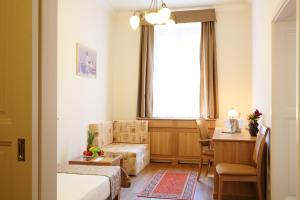 A seating area at Hotel Historia & Historante