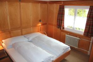 Ein Bett oder Betten in einem Zimmer der Unterkunft Chalet Good