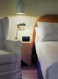 A bed or beds in a room at Boutique Hotel H10 Big Sur - Adults Only