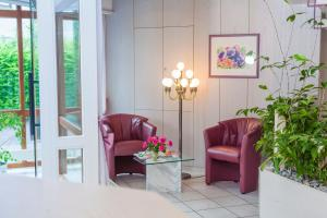 Ein Sitzbereich in der Unterkunft Hotel Apart