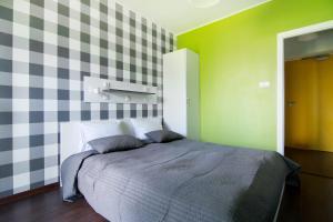 Cama o camas de una habitación en Tatamka Hostel