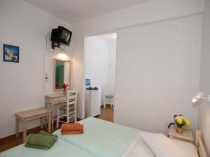 Ένα ή περισσότερα κρεβάτια σε δωμάτιο στο Hotel Skios