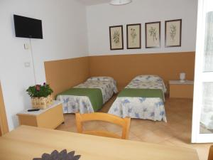 A bed or beds in a room at Agriturismo Le Giare