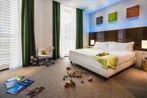 Ein Bett oder Betten in einem Zimmer der Unterkunft Hotel degli Arcimboldi