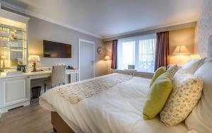 Ein Bett oder Betten in einem Zimmer der Unterkunft Ara Dune Hotel