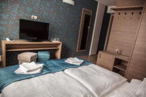 A bed or beds in a room at Vitta Hotel Superior Budapest