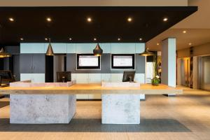 The lobby or reception area at ibis Hotel München Garching