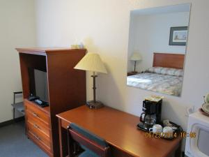 A bed or beds in a room at Lazy J Motel