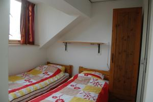 "A bed or beds in a room at Vakantieoord ""de Peppelhoeve"""