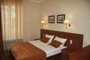 Кровать или кровати в номере Отель Тепло