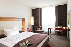 Ein Bett oder Betten in einem Zimmer der Unterkunft Mercure Hotel Stuttgart Airport Messe