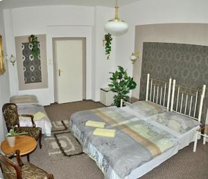 Postel nebo postele na pokoji v ubytování Hotel Green House