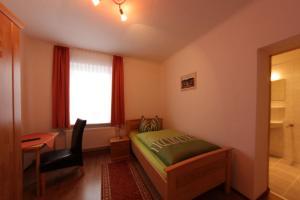 Ein Bett oder Betten in einem Zimmer der Unterkunft Pension Am Ostbahnhof
