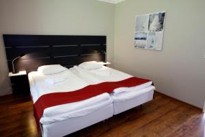 Säng eller sängar i ett rum på Rasta Håby