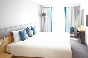 A bed or beds in a room at Novotel London Wembley